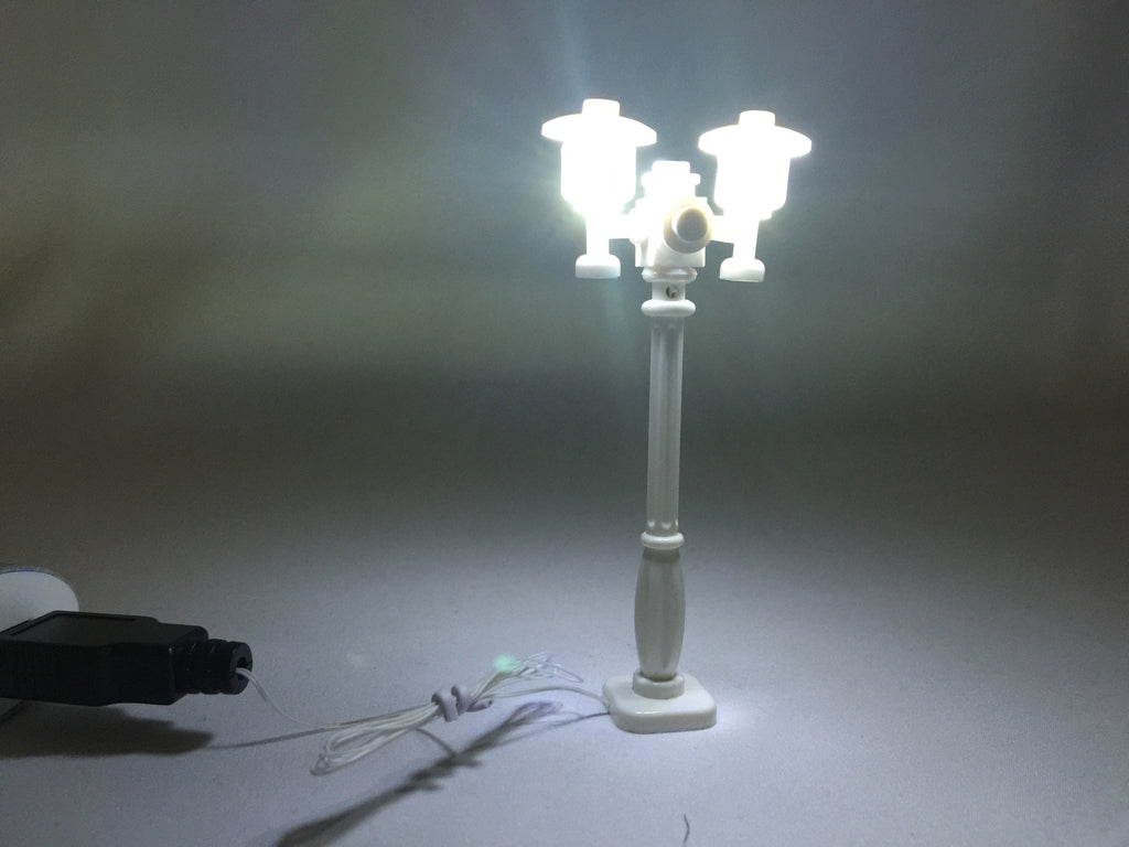 Brick Loot LED Lighting for LEGO - White Double Light Street Lamp for LEGO Cities, with a white wire, powered through USB. In this photo, the lights are on.
