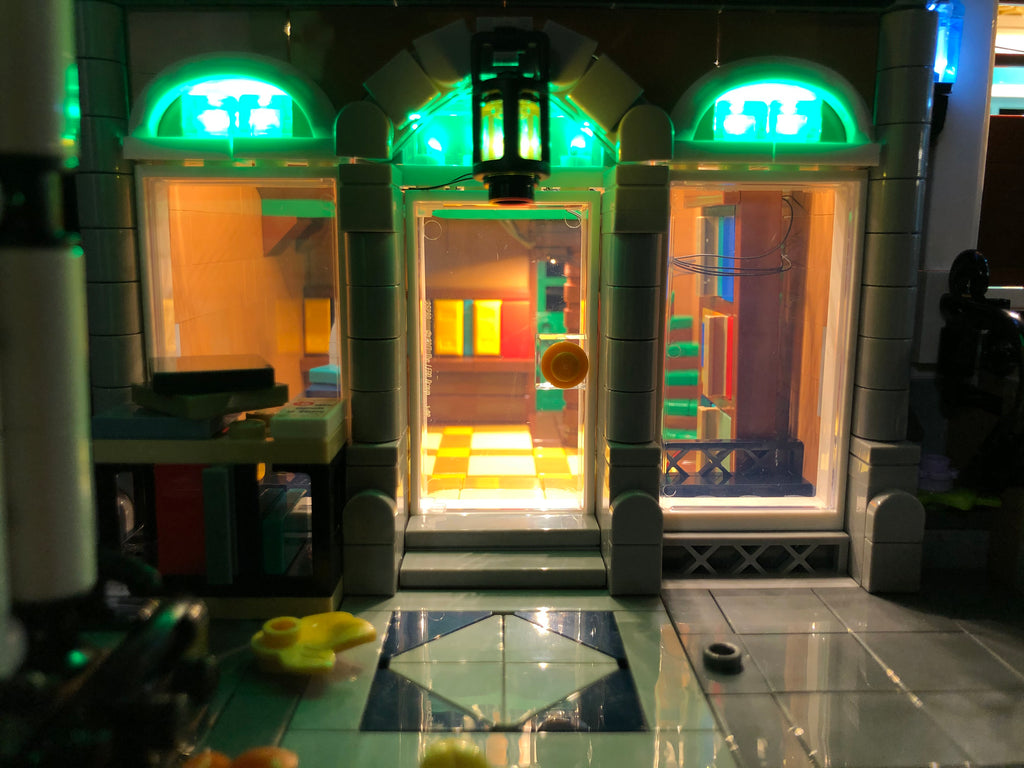 Close-up of the LEGO Createor Expert Bookshop set 10270 with the Brick Loot custom LED Lighting kit.