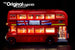 Side view of the LEGO London Bus set 10258, brilliantly illuminated with the Brick Loot LED Light Kit.
