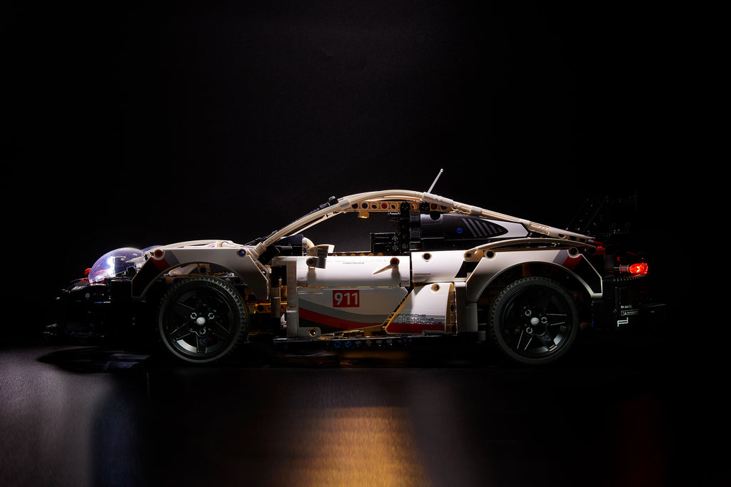 Side view of the LEGO Porsche 911 RSR set 42096 with the custom-designed Brick Loot LED Light Kit installed.
