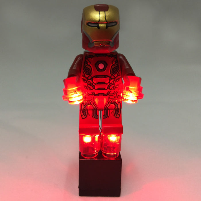 Brick Loot Lights for LEGO - Red LED Lights powered by a black 2x3 battery brick (AG3 batteries included). Shown here with Iron Man minifigure (not included). In this picture, the red lights are on.