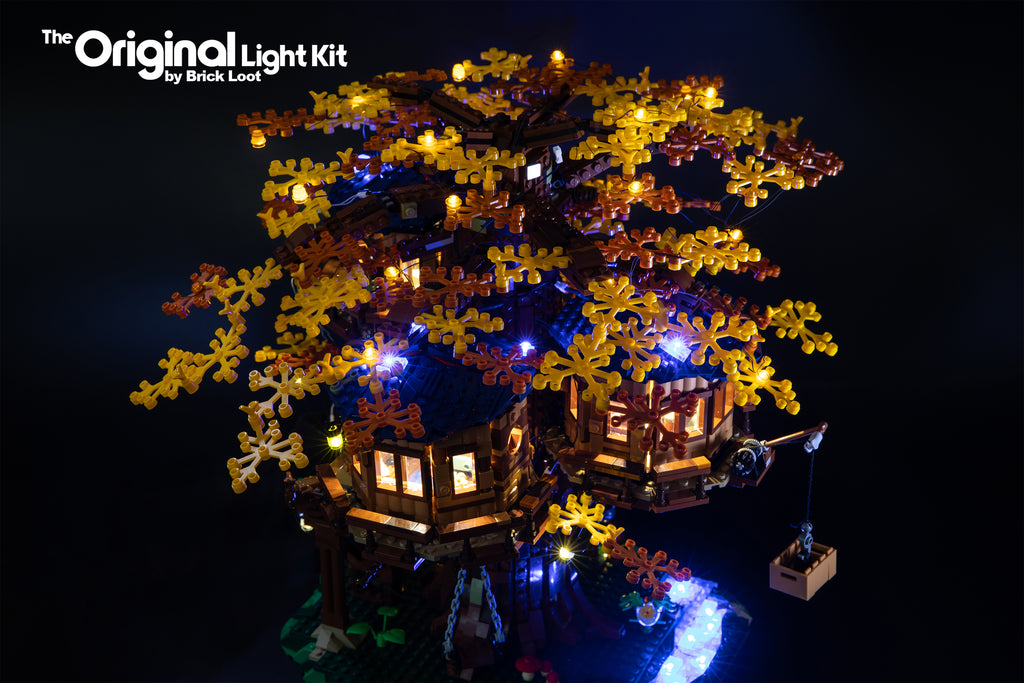 LEGO Ideas Tree House set 21318, fully illuminated with the Brick Loot LED Light Kit.