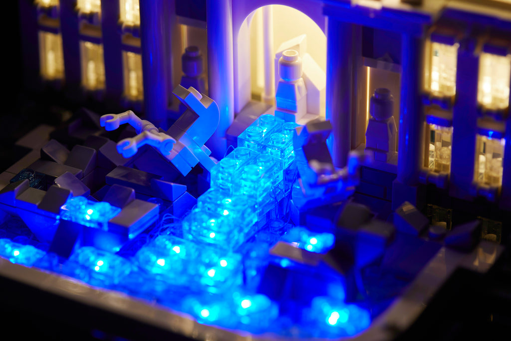 Close up of the illuminiated blue water of the LEGO Architecture Trevi Fountain set 21020 with the Brick Loot LED kit installed.