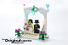 LEGO Wedding Favor Set 40165, illuminated with the custom Brick Loot LED Light Kit with colorful twinkling lights.