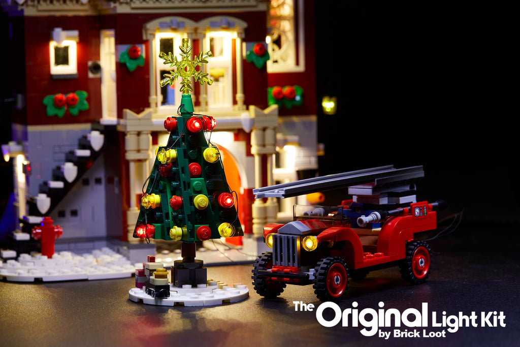 Close up of the  LEGO Winter Village Fire Station set, fully illuminated with the Brick Loot Custom LED Light kit! Beautiful LED lights light up the inside and outside of the Fire Station, Christmas tree, fire truck, and more!!