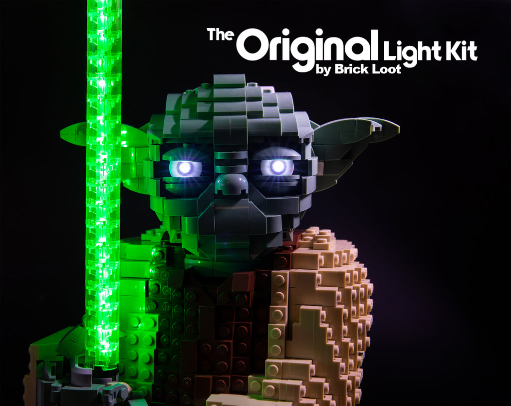 Close-up of the LEGO® Star Wars Attack of The Clones Yoda Building Model and Collectible Minifigure with Lightsaber set 75255  with the Brick Loot LED Lighting Kit, illuminating Yoda's eyes and lightsaber.