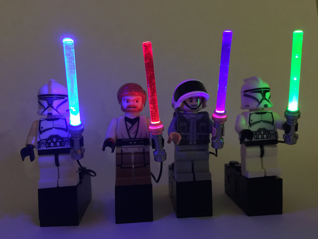 Brick Loot LED Colored Lightsabers Light Swords in blue, red, purple, green - fits LEGO Minifigures - powered by black battery brick (batteries included). LEGO Minifigures not included.