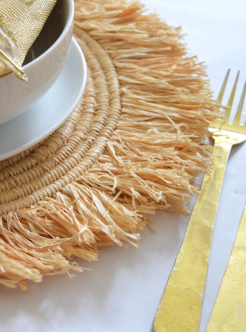 Moroccan Raffia Placements make a bold statement in your home interior hand woven in Morocco from Raffia grass finished with a decorative raffia fringe.  Perfect to create a bohemian style of beach shack look your home interior.  On trend this season for restaurants and bistro cafe. Perfect for Wedding parties to create a chic look yo you table display.