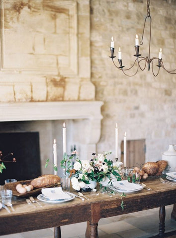 Rustic Tablescape Featuring White Taper Candles