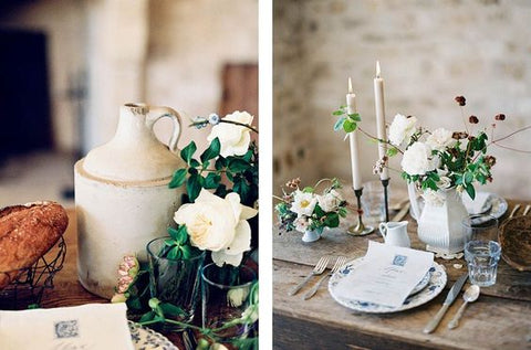rustic tablescape featuring greenery and white taper candles