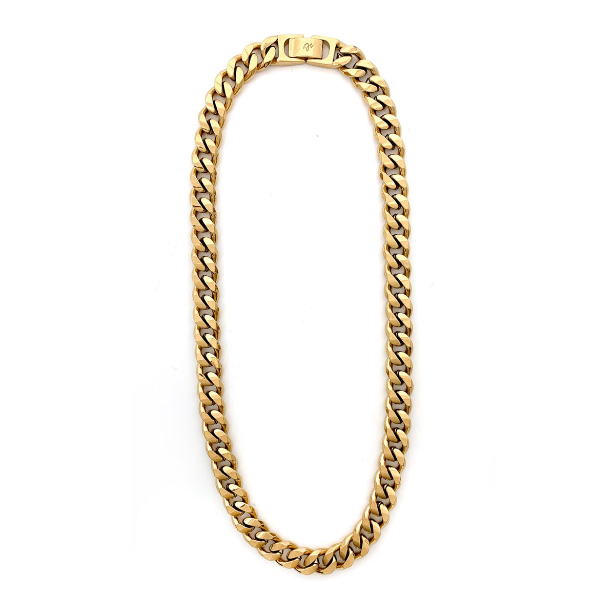 A medium length gold curb chain necklace on a white background