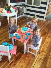 R to L: Charlotte, Kendal, and Scarlett paint their teal pumpkins!