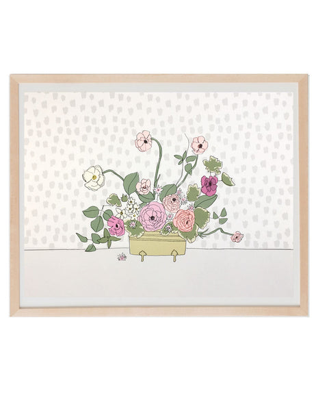 Bouquet of poppies and prim roses in a brass container illustrated by Hartland brooklyn framed in a natural wood frame.