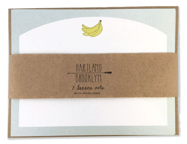 Banana Stationery set pack wrapped in brown paper. Illustrated by Hartland Brooklyn.