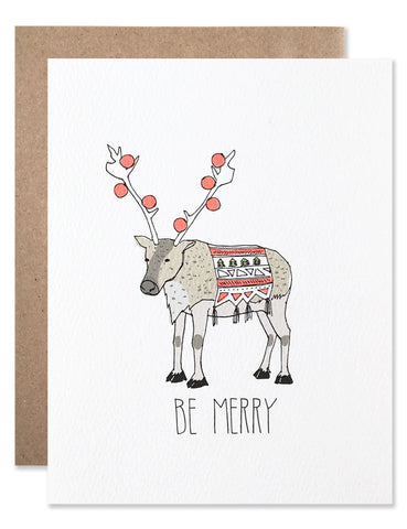 Be Merry reindeer with neon ornaments hanging from the antlers and a festive blanket. Illustration by Hartland Brooklyn