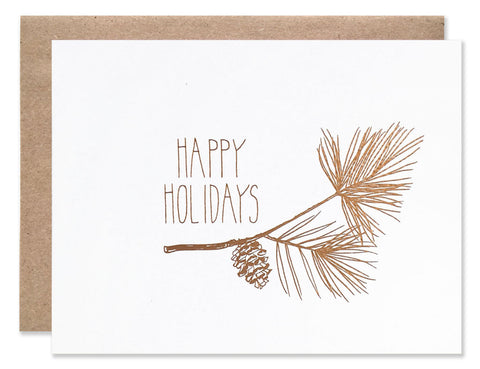 Happy Holidays with pine sprig and pinecones in copper foil. Illustrated by Hartland Brooklyn