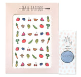 Temporary nail tattoos and polish set with illustrations by Hartland Brooklyn of fruits and vegetables. Light blue polish by Zoya.