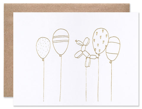Gold foil stamped celebratory balloons illustrated by Hartland Brooklyn.