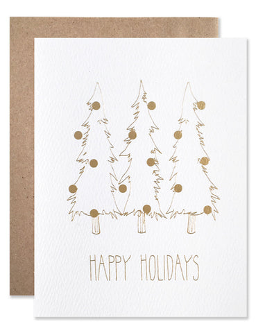 Three slender pine trees with ornaments illustrated by Hartland Brooklyn in gold foil