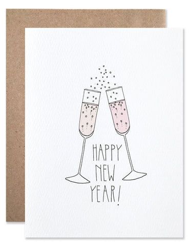 Two champagne glasses cheers against each other with Happy New Year written below. Illustration by Hartland Brooklyn