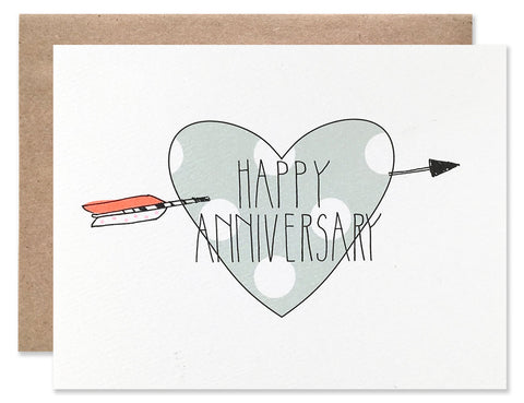Large green with white polka dot heart with a neon arrow through it. Written over top is Happy Anniversary. All illustrated by Hartland Brooklyn.