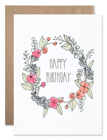 Happy Birthday floral wreath with blue berries, pink and orange flowers and eucalyptus sprigs illustrated by Hartland Brooklyn.