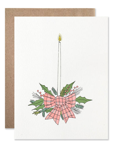 Holiday arrangement with a plaid bow and tall skinny candle illustrated by Hartland Brooklyn
