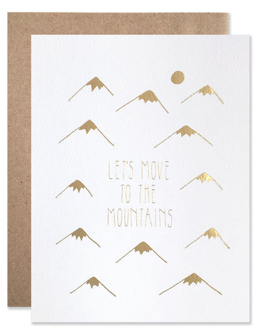 "Stamped in gold foil tiny little mountains with the text ""Let's Move to the Mountains"" centered. Illustrated by Hartland Brooklyn"