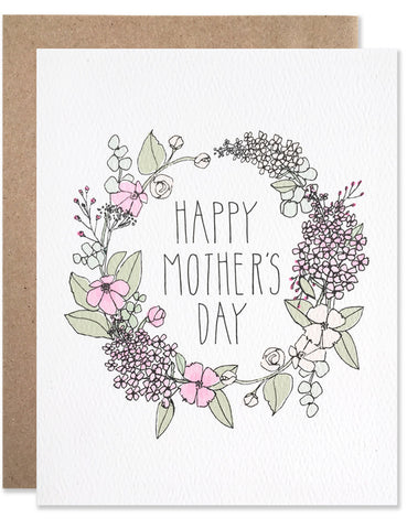 Floral wreath of lilacs in pinks with happy mother's day written in the center. Illustrated by Hartland Brooklyn