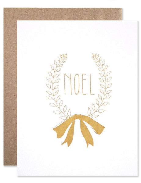 Noel laurel wreath illustrated by Hartland Brooklyn featured in gold foil.