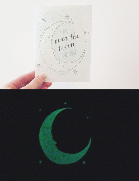 Moons and stars glow in the dark on this card!