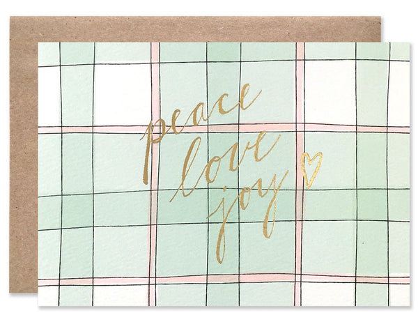 Peace Love Joy gold foil handwriting on a green and red plaid background. Illustrated by Hartland Brooklyn