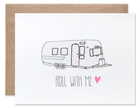 Vintage airstream trailer with a pink polka dot door with 'Roll with me' written below. Illustrated by Hartland Brooklyn.