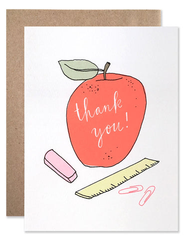 Illustration of a red apple, eraser, wooden ruler and paper clips by Hartland Brooklyn.