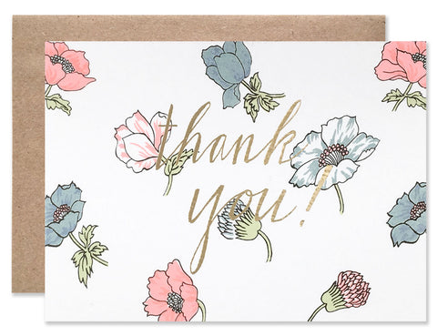 Gold foil thank you with a background of blue and pink poppies. Illustrated by Hartland Brooklyn.