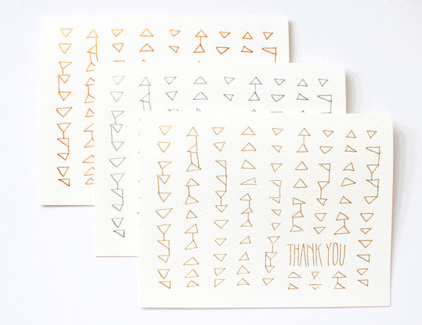 Thank You foil trio of copper, silver and gold letter pressed triangle design. Created by Hartland Brooklyn.