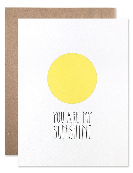 Graphic circle yellow sun with 'You Are My Sunshine' written underneath. Illustration by Hartland Brooklyn