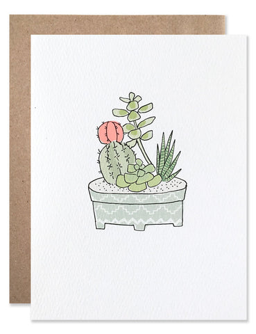 Small cacti and succulent garden in a light blue pot illustrated by Hartland Brooklyn.