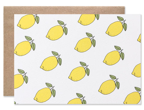 multiple neon yellow whole lemons with green leafs create a pattern all over this card by Hartland Brooklyn.