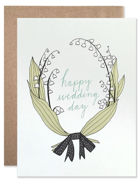 lily of the valley sprigs creating a laurel around the words Happy Wedding Day. Illustrated by Hartland Brooklyn