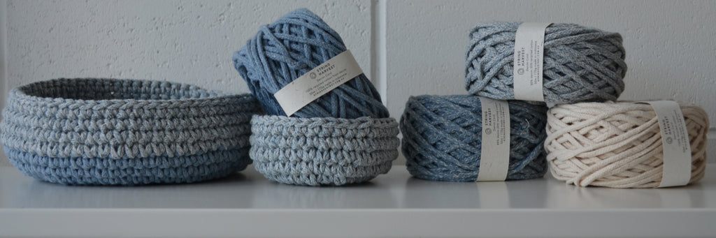 image of crocheted bowls and balls of rope made from recycled denim cotton