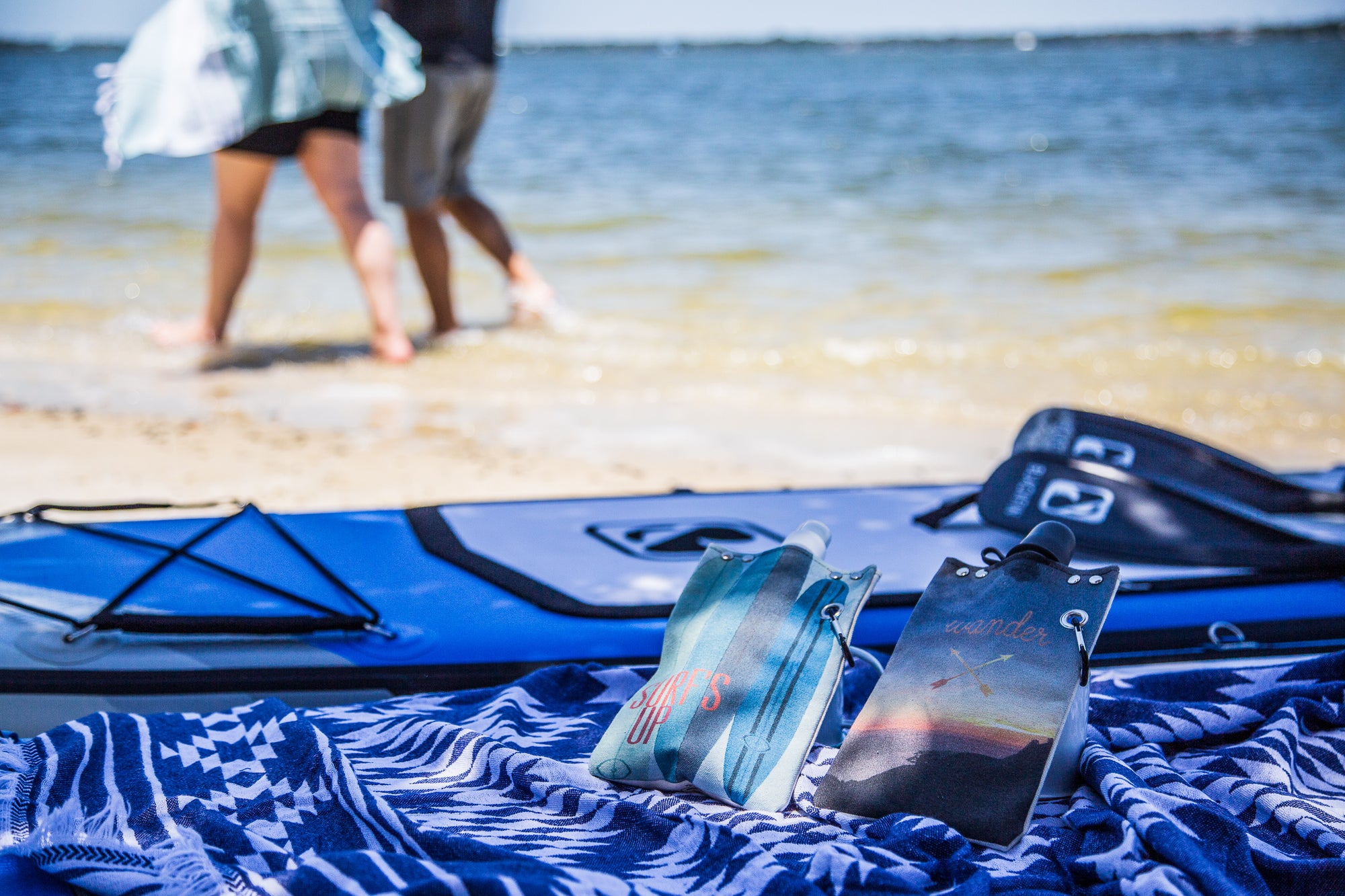 beach towels with paddleboards and flexible flasks