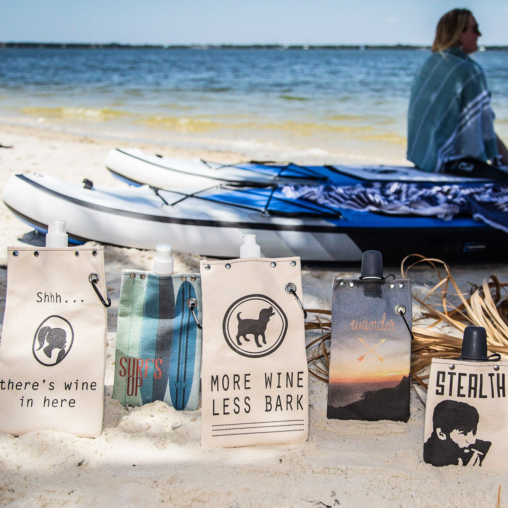 flasks by paddleboards on beach