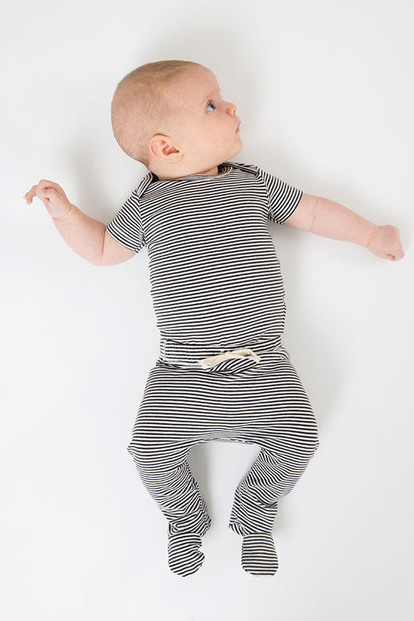 baby onesie in nearly black|off white stripe