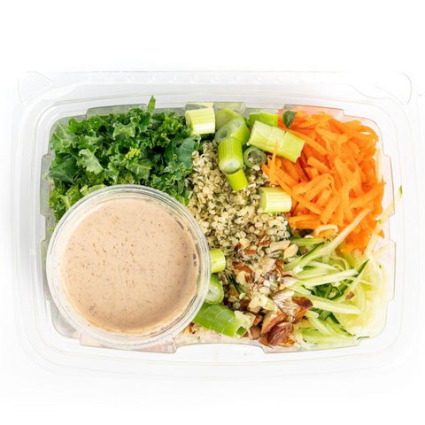 organic ingredients: quinoa (gently steamed), carrots, cucumber, kale, almonds, scallion, hemp seed, cilantro.  almond dressing: almond butter, cashew butter, tamari, sesame oil, cilantro, himalayan salt, red chili flake, alkaline water.