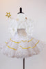 White tulle dress with  small gold stars &smocked bodice has detachable white feather wings, a gold star wand and a small gold tiara headpiece. Back