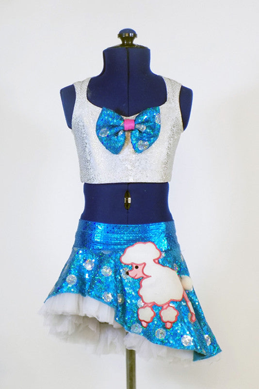 Turquoise sparkle skirt with silver polk-a-dots, white petticoat skirt & pink poodle.Separate pink panty and white half-top with matching turquoise bow accent. Front