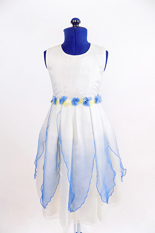 White organza dress with sheer blue overlay and blue flowers around waist. Front