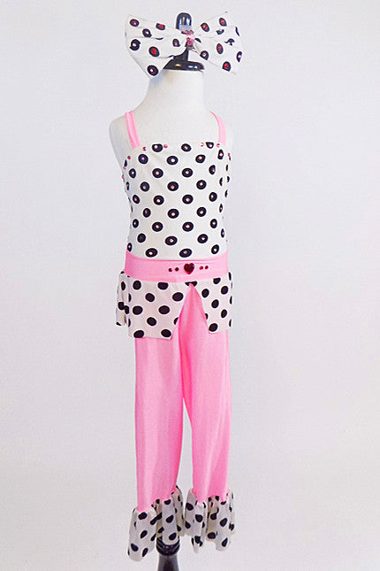 Pink capri pant with black& white polk-a-dot ruffle, matching polk-a-dot crystalled top with peplum & pink waistband.  Has large matching bow hair piece.  Front