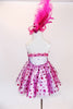 A-line dress has magenta bodice & matching polk-a-dot bottom.Crystals on front & back .Has gloves with pearls & marabou trim, & decorated, feather head piece. Back